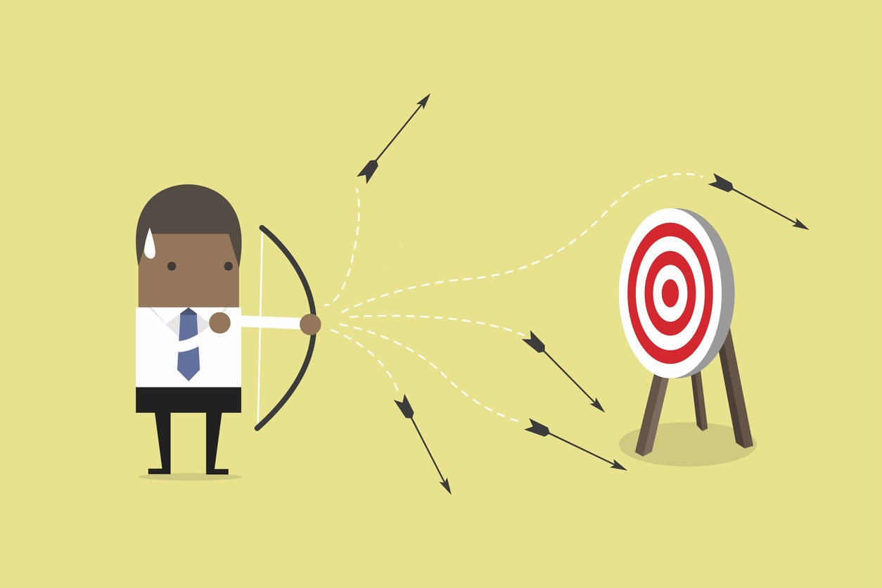 Businessman shooting arrows but missing. vector. concept: digital marketing