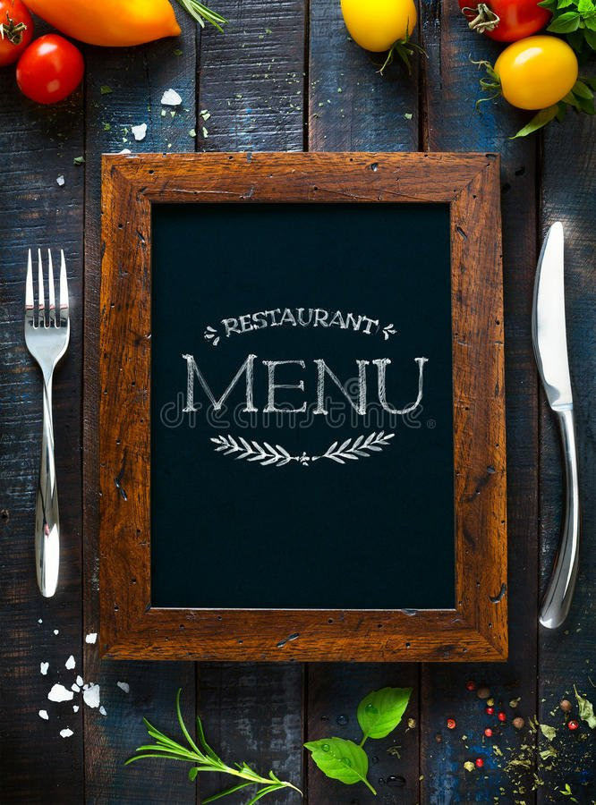 Cover or restaurant menu with fork and knife on each side to illustrate the idea of menu prices and design