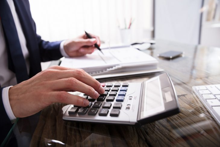 Hands clicking on computer. Concept: how to file taxes