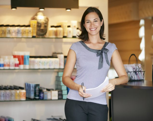 Latino woman and small business owner in her store, to luustrate the idea of small business loans for women