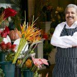 "Male Hispanic Florist Outside Shop Smiling To Camera, to illustrate ""ITIN loans""."