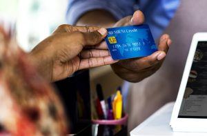 two hands holding a business credit card