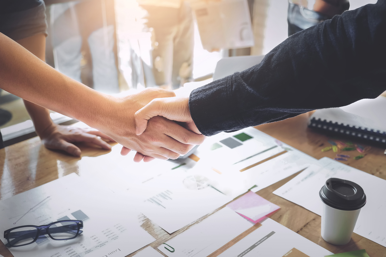 Business Partnership concept. business man shaking hands during a meeting in the office, success, dealing, greeting. Concept: