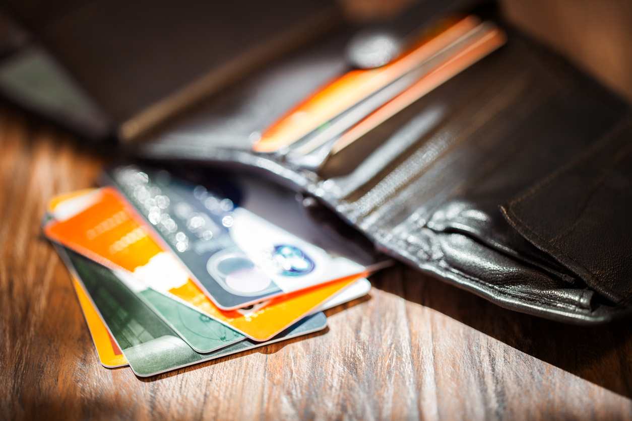 Leather men's open wallet with credit cards. Concept: pay off credit cards