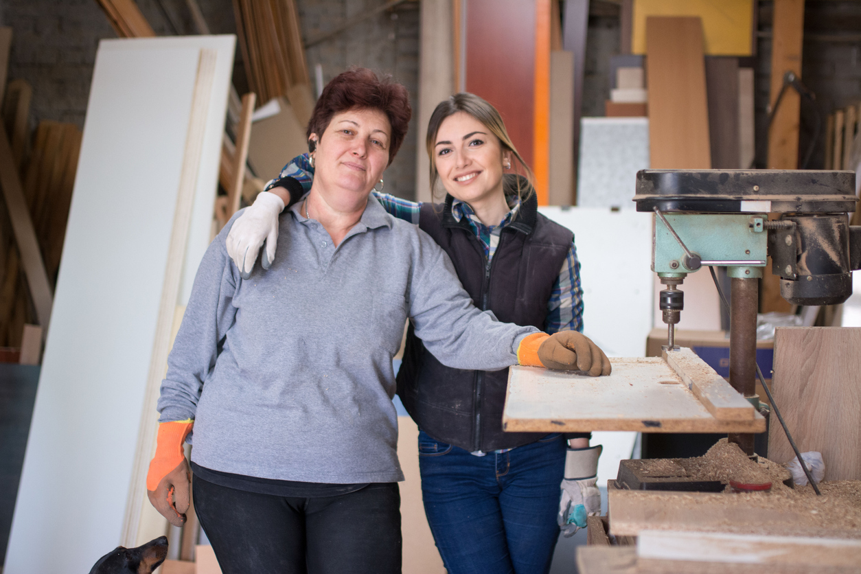 Mother and daughter in a wood workshop. Concept: family business.