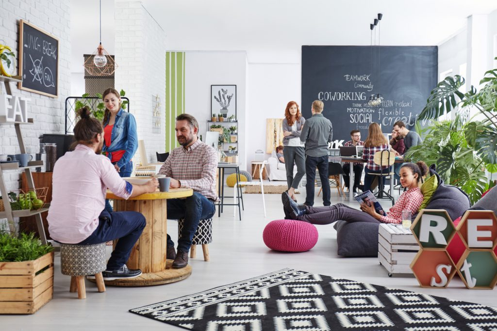 People working in modern and creative agency. Concept: how to organize your office space.
