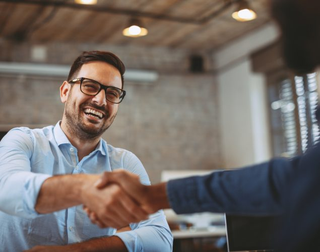 Entrepreneur shaking hands with representative of a large company.Concept: vendor agreement