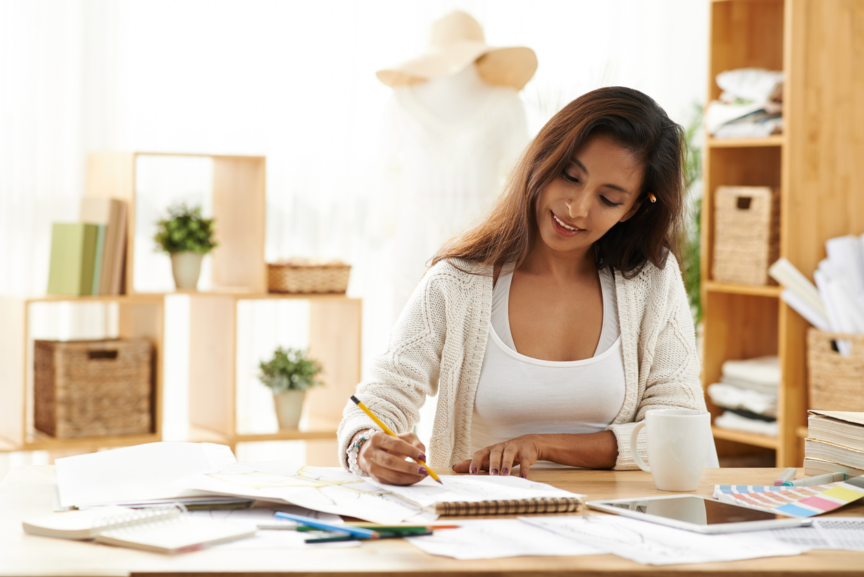 Female business owner in her office working on her business proposal. Concept: How to write a business proposal