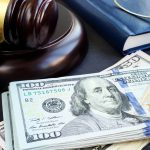 Gavel and dollar banknotes. Concept: What is bankruptcy?