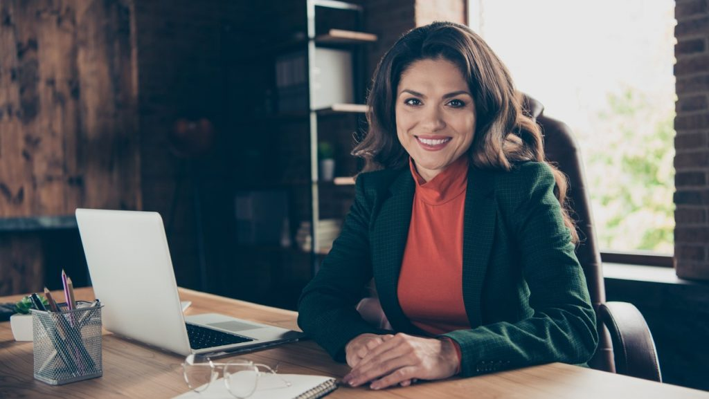 Close up photo of attractive middle-aged she her business lady woman speaker sitting big office chair ready to begin training wearing formalwear suit. concept: skype for business