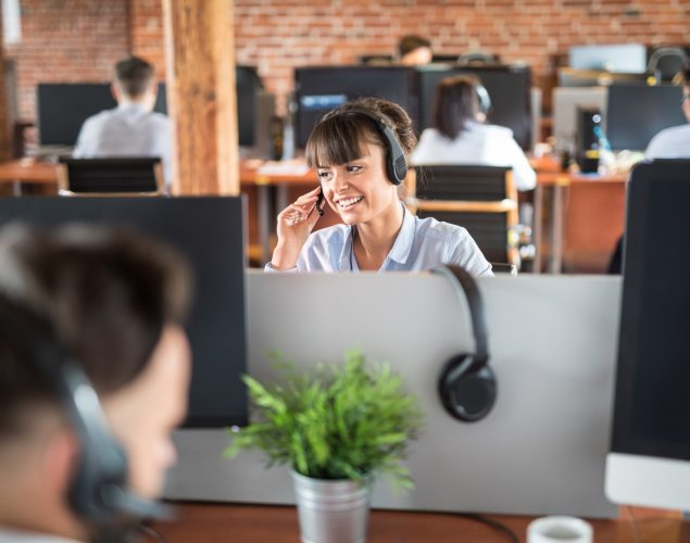 Customer support member with headset in office. Concept: best business phone systems.