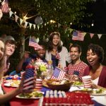Portrait Of Friends celebrating the 4th Of July Holiday at a Backyard Party. Concept: how to increase sales during the 4th of july