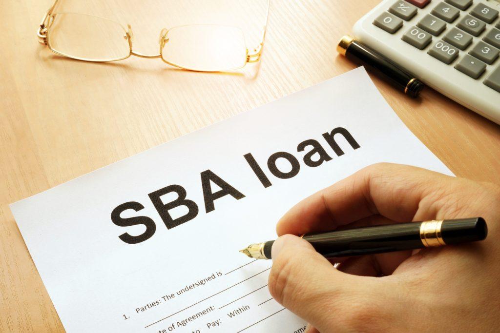SBA loan form on a table. Concept: SBA loans vs Camino Financial loans
