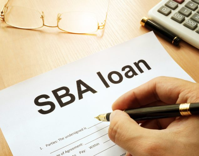 SBA loan form on a table. Concept: SBA loans vs Camino Financial loans