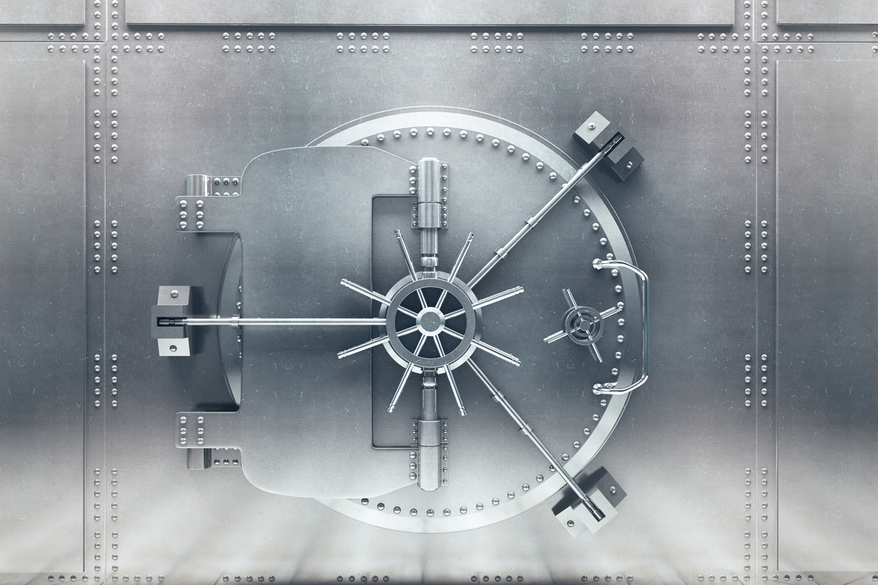 Front view of light silver bank vault door, closed. Bank technology to keep information safe and secure. Concept: How does Camino Financial use bank technology to offer the best loan process?