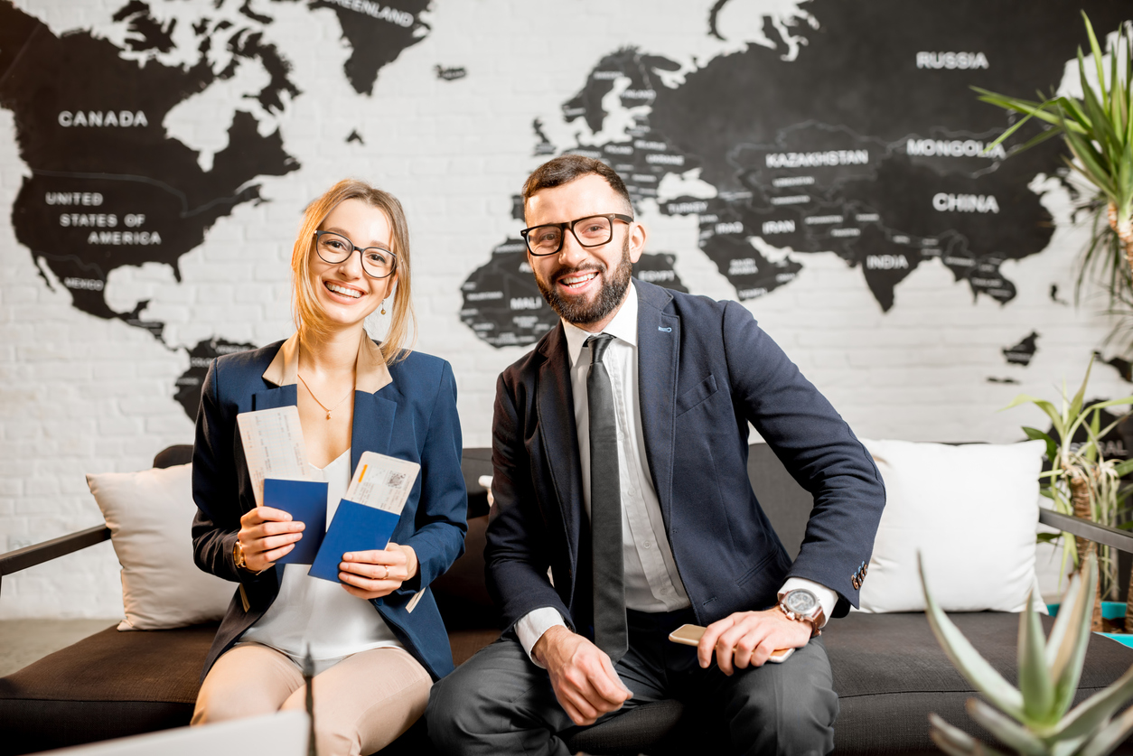 Couple with passports at travel agency. Concept: Online Travel Agent