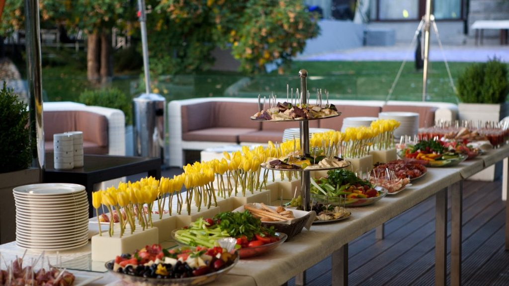 Buffet served table with snacks,fruits,canape,sweets and appetizers. Catering event plate service. Smorgasbord,food choice of breakfast in restaurant. Concept: how to expand your food truck business
