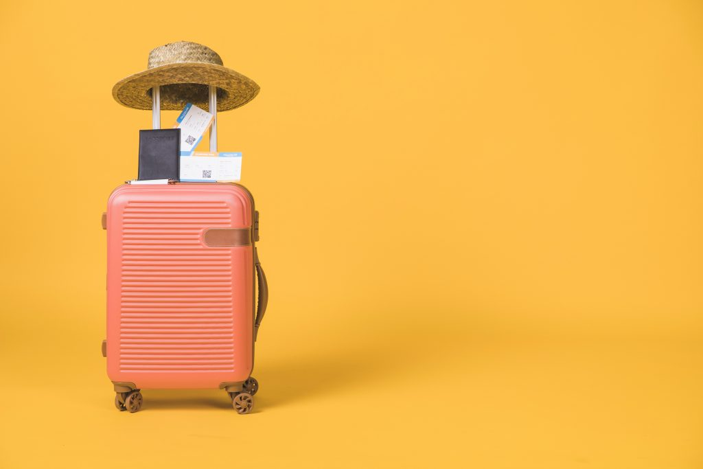 suitcase ready for flight. concept: online travel agent. Designed by Freepik