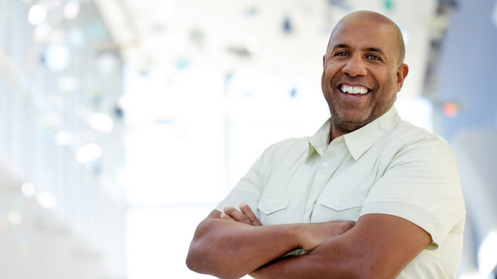 Mature African American smiling and looking at the camera. concept: inventory financing