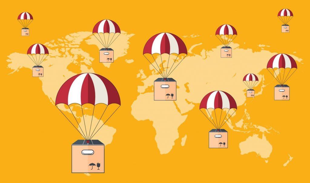 Envio con paracaídas. Dropshipping. PAquetes volando con paracaídas. Servicio de envío. Flat design. Concept: dropshipping