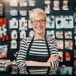 Portrait of women entrepreneur in bicycle shop with arms crossed. Concept: women entrepreneurs.
