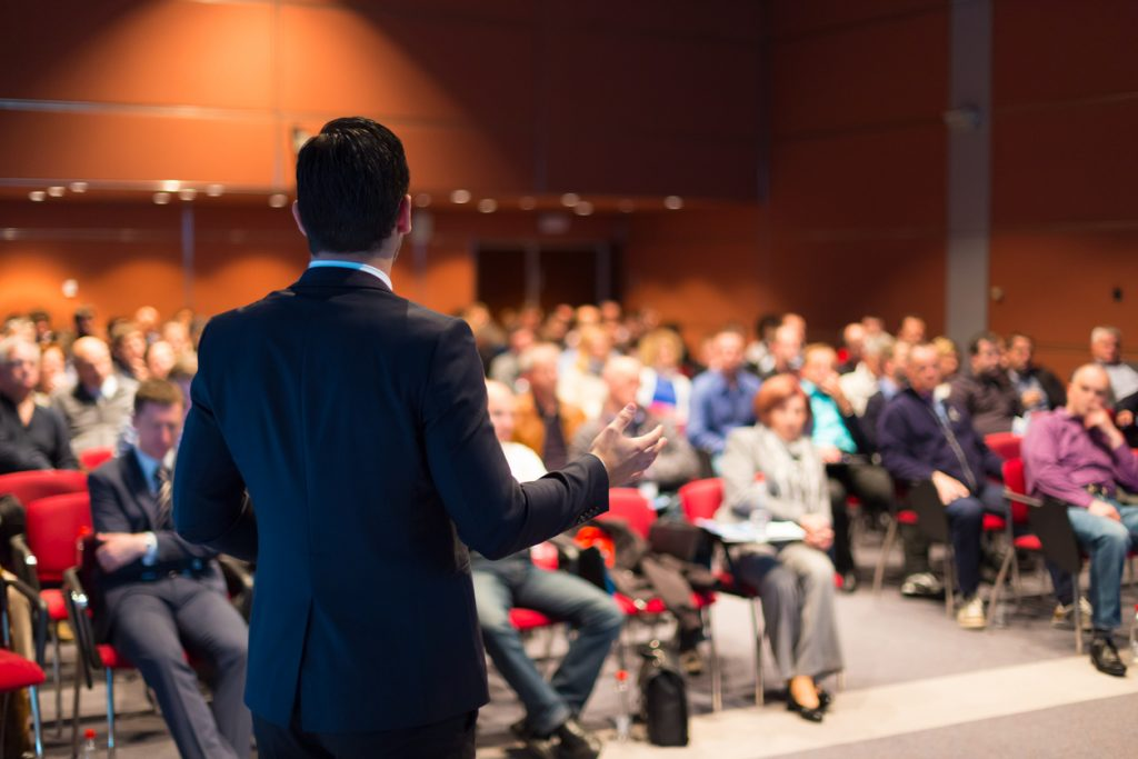 Speaker at Business Conference and Presentation. Audience at the conference hall. Concept: best business events and conferences