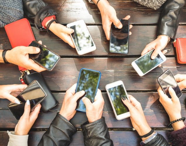 People group having fun together using smartphones - Detail of hands sharing content on social network with mobile smart phones - Technology concept with millennials online with cellphones. Concept: community, social media