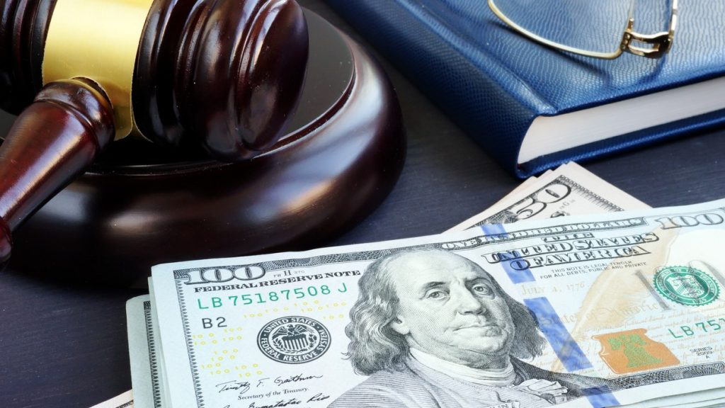 Litigation finance. Gavel and dollar banknotes. Bail bonds. Concept: financial awareness