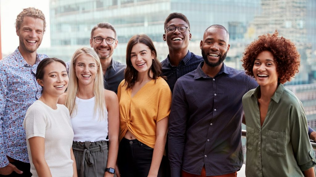 Group portrait of a creative business team standing outdoors, three quarter length, close up. Concept: apply for a business loan
