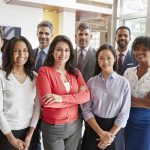Smiling corporate business team, group portrait. concept: minority business certification