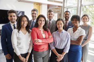 Smiling corporate business team, group portrait. concept: minority business certification