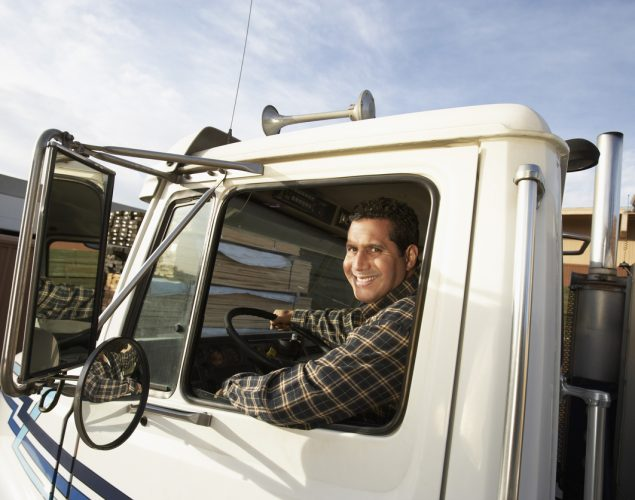 Truck Driver Behind the Wheel. Concept: commercial vehicle