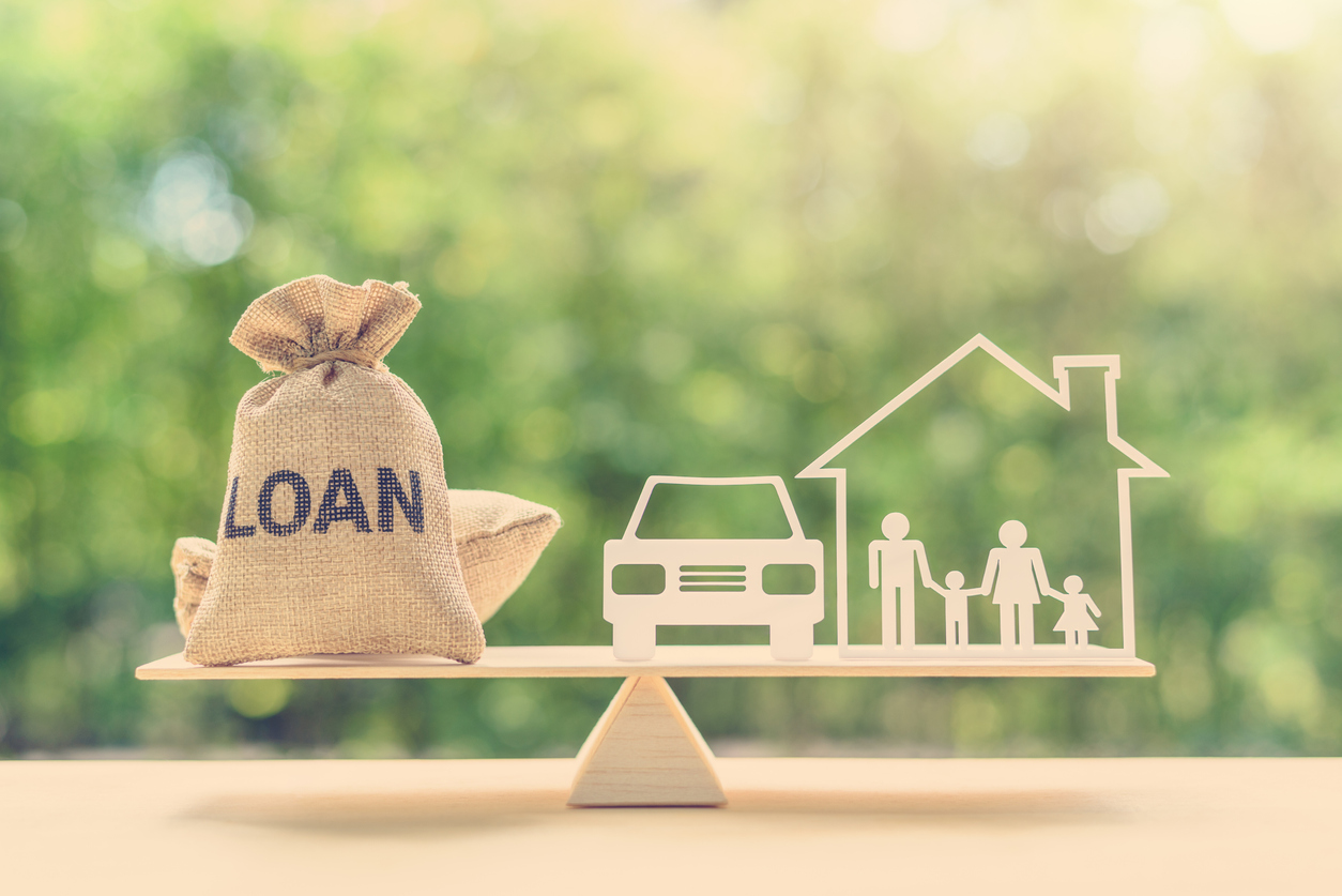 Loan bags, family in a house on balance scale, depicts secured vs unsecured business loans
