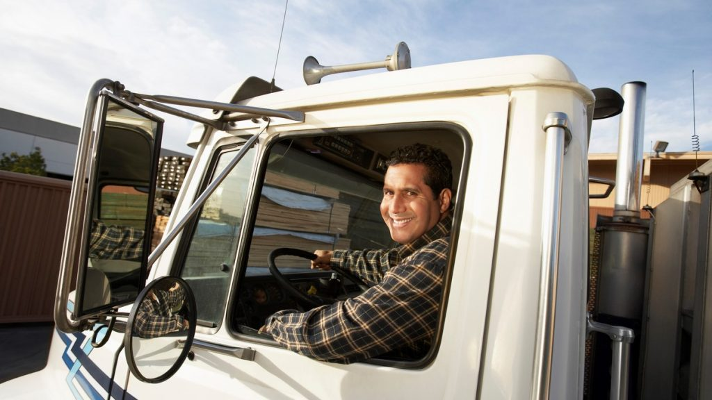Truck Driver Behind the Wheel. Concept: truck financing
