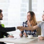 Bank customeres shaking hands with bank representative. Concept: Microloans vs personal loans