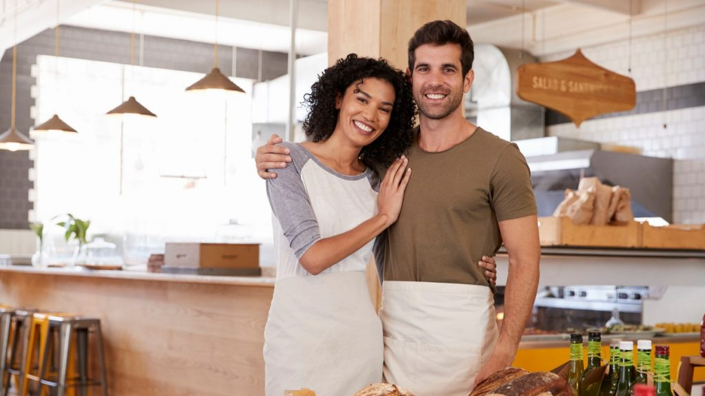 Portrait Of Couple Running Organic Food Store Together. concept:L restaurant business plan