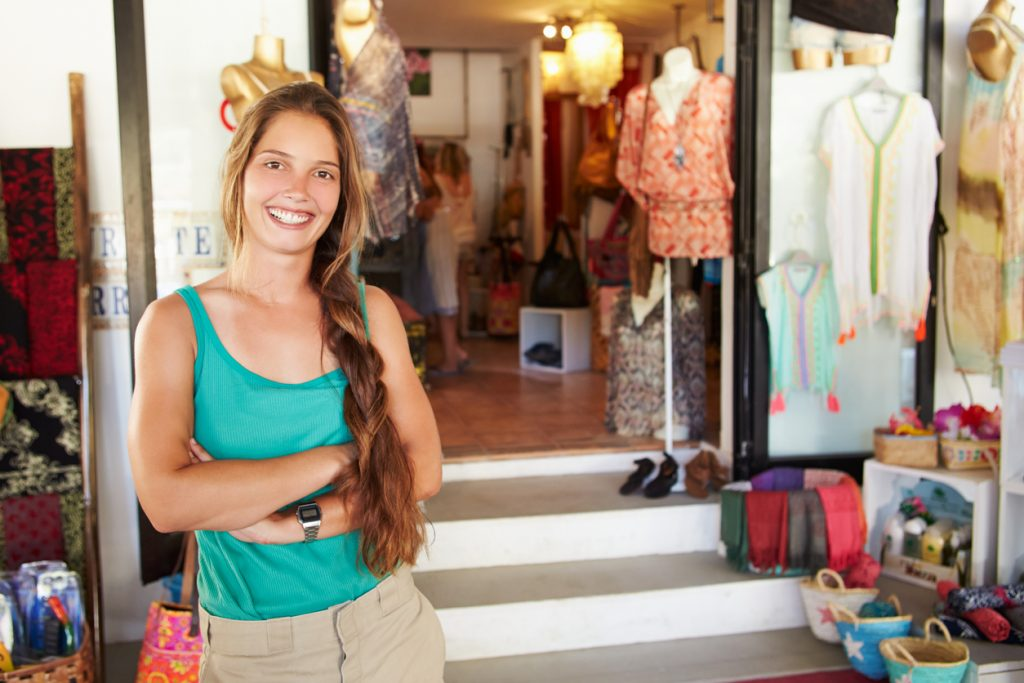 Portrait Of Female Clothing Shop Owner Smiling To Camera. Concept: social impact
