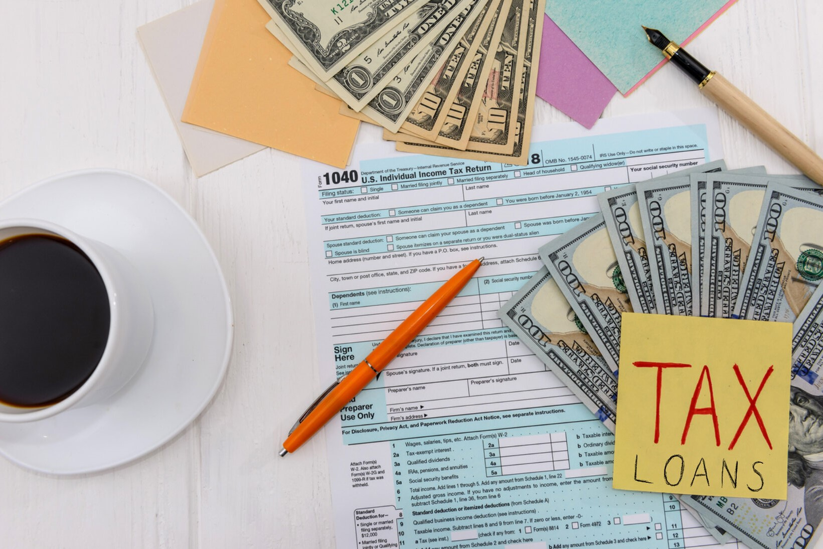 Tax declaration with dollars and coffee top view. Concept: tax loans