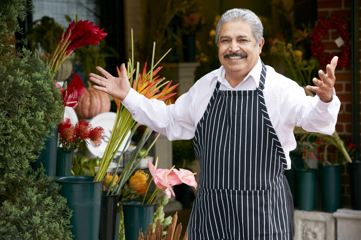 Portrait Of Male Florist Outside Shop Smiling To Camera. Concept: increase profit margin