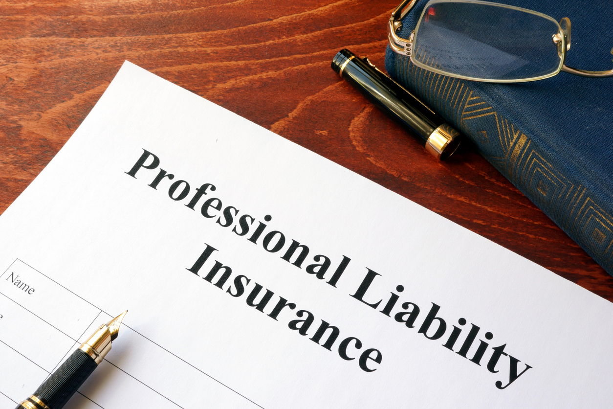 Professional liability insurance policy on a table. Concept: Professional Liability Insurance Cost