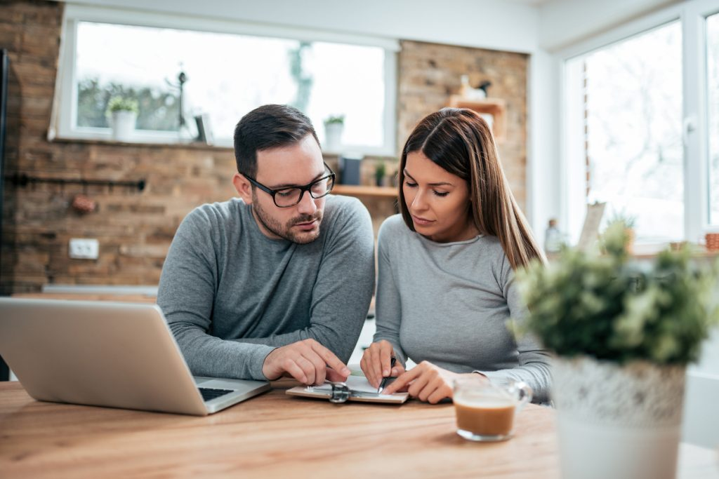 Couple filing taxes at home. Concept: Is social security taxable?