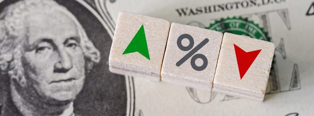 Concept idea of FED, federal reserve system is the central banking system of the united states of America and change interest rates. Percentage icon and arrow symbol on wooden cube. concept: stockbroker