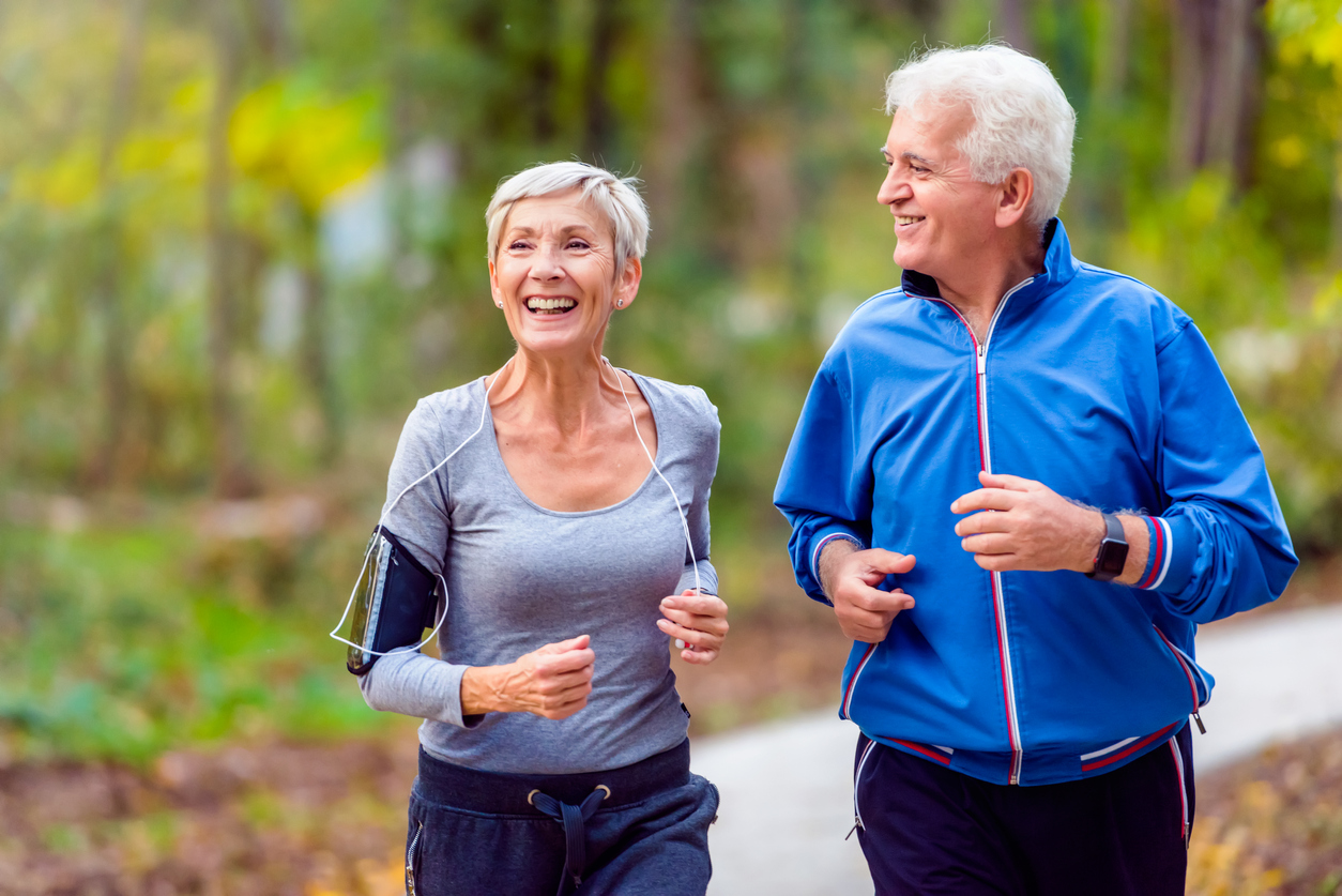Smiling senior couple jogging in the park. Concept: How to invest your IRA in the stock market