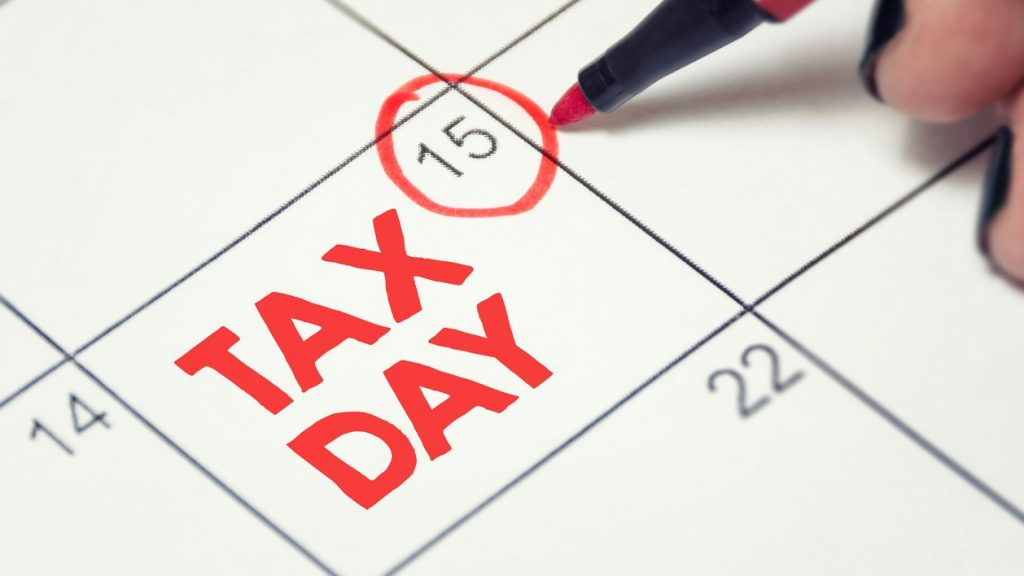 Tax day concept. The USA tax due date marked on the calendar. concept: quarterly taxes
