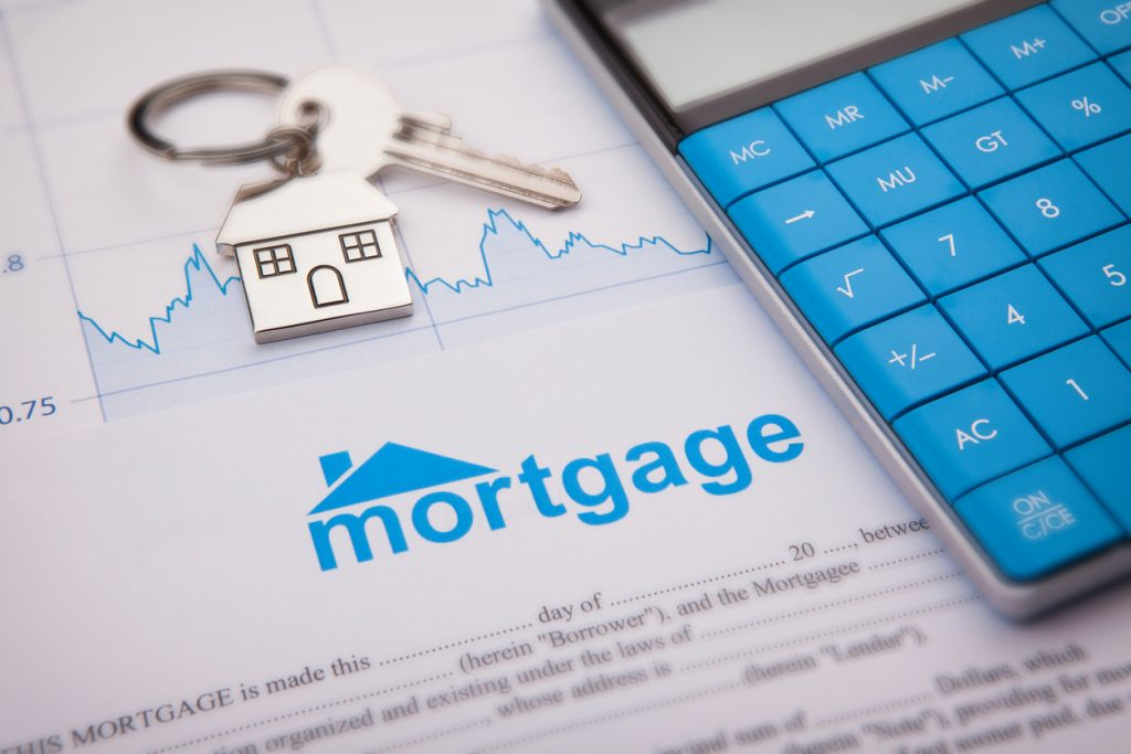 An empty mortgage application form with house key. concept: pay mortgage with credit card