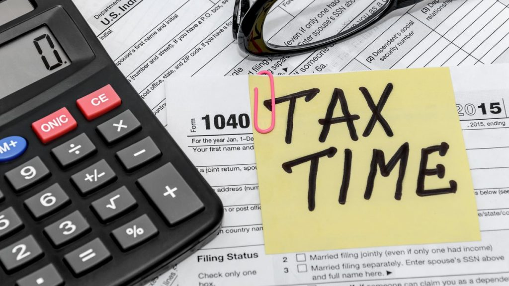 tax form with callculator and glasses. concept: non taxable income