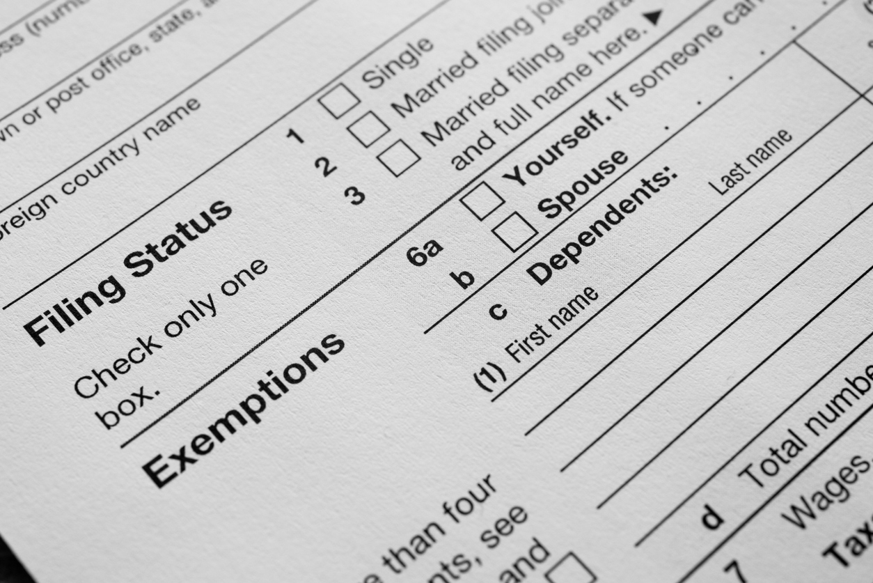 US Income tax return 1040 close up filing status and exemptions. concept: What happens if you file taxes late?