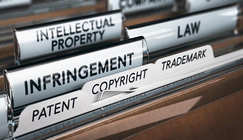 ilustración 3D de un folder con pestañas sobre propiedad intelectual. Concept: Derechos de autor, marca registrada o patente