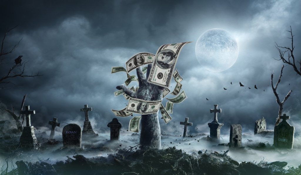 Buried Zombie Rising Out Of Ground In Misty Cemetery with flying dollars. Concept: zombie debt