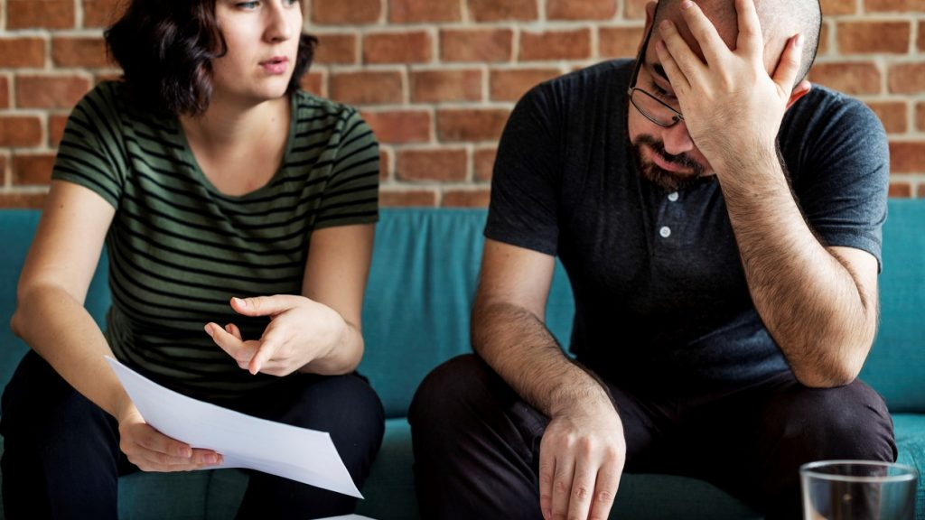 Couple managing the debt. concept: Why Did My Credit Score Drop